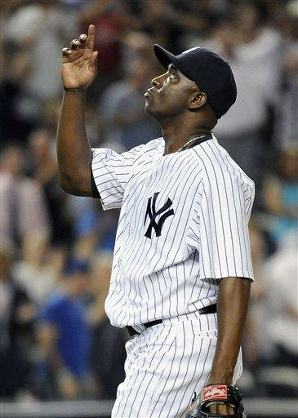 New York Yankees relief pitcher Rafael Soriano points skyward after the Yankees defeated the Toronto Blue Jays 2-1 in a baseball game on Tuesday, Aug., 28, 2012, at Yankee Stadium in New York. (AP Photo/Kathy Kmonicek)