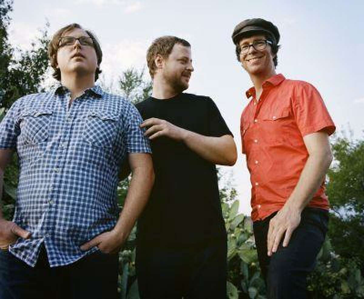 """This publicity image released by Sony shows members of Ben Folds Five, from left, Robert Sledge, Darren Jessee and Ben Folds. The band's latest album, """"The Sound Of The Life Of The Mind,"""" was released on Tuesday, Sept. 18, 2012. (AP Photo/Sony, Autumn de Wilde)"""