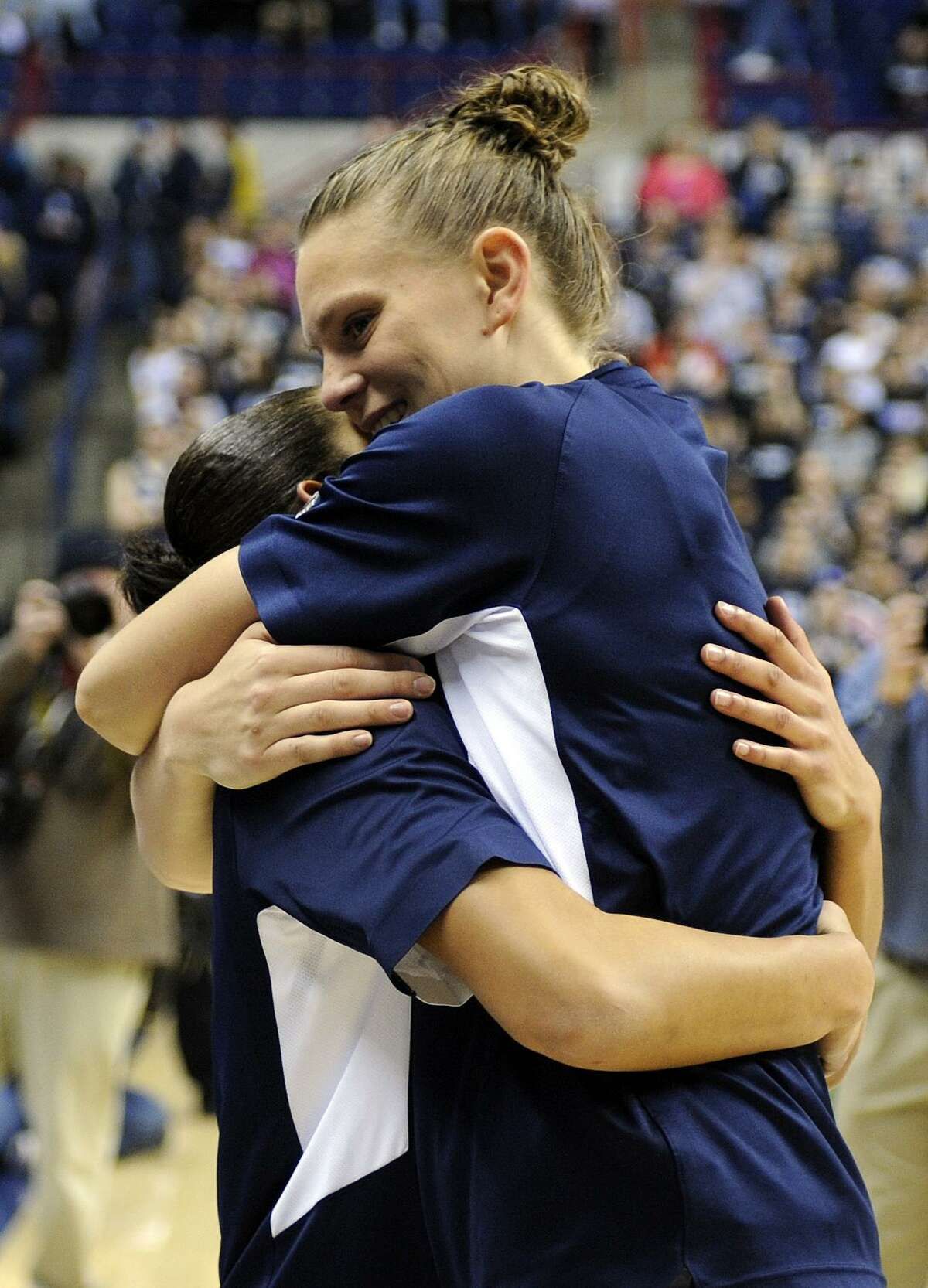 Heather Buck, right, hugs Bria Hartley during Senior Night ceremonies before Connecticut's NCAA basketball game against Seton Hall in Storrs, Conn., Saturday, Feb. 23, 2013. (AP Photo/Fred Beckham)