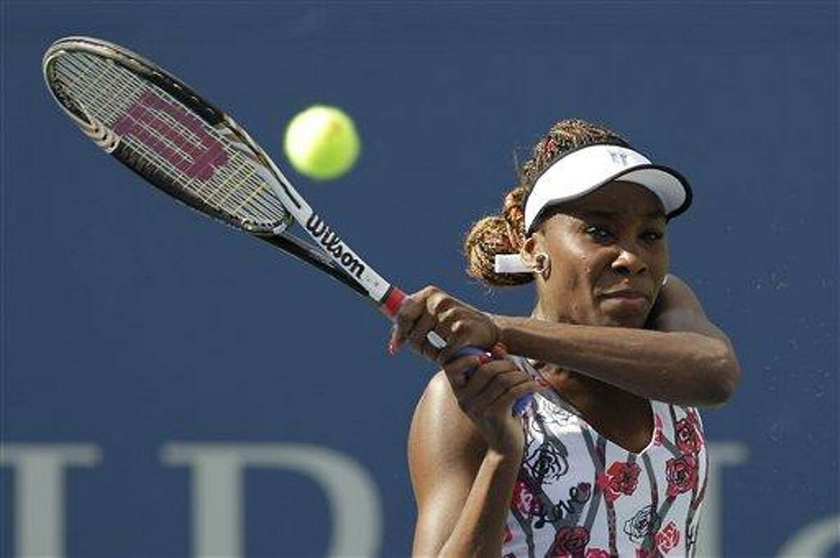 Venus Williams returns a shot to Bethanie Mattek-Sands in the first round of play at the 2012 US Open tennis tournament, Tuesday, Aug. 28, 2012, in New York. (AP Photo/Kathy Willens)