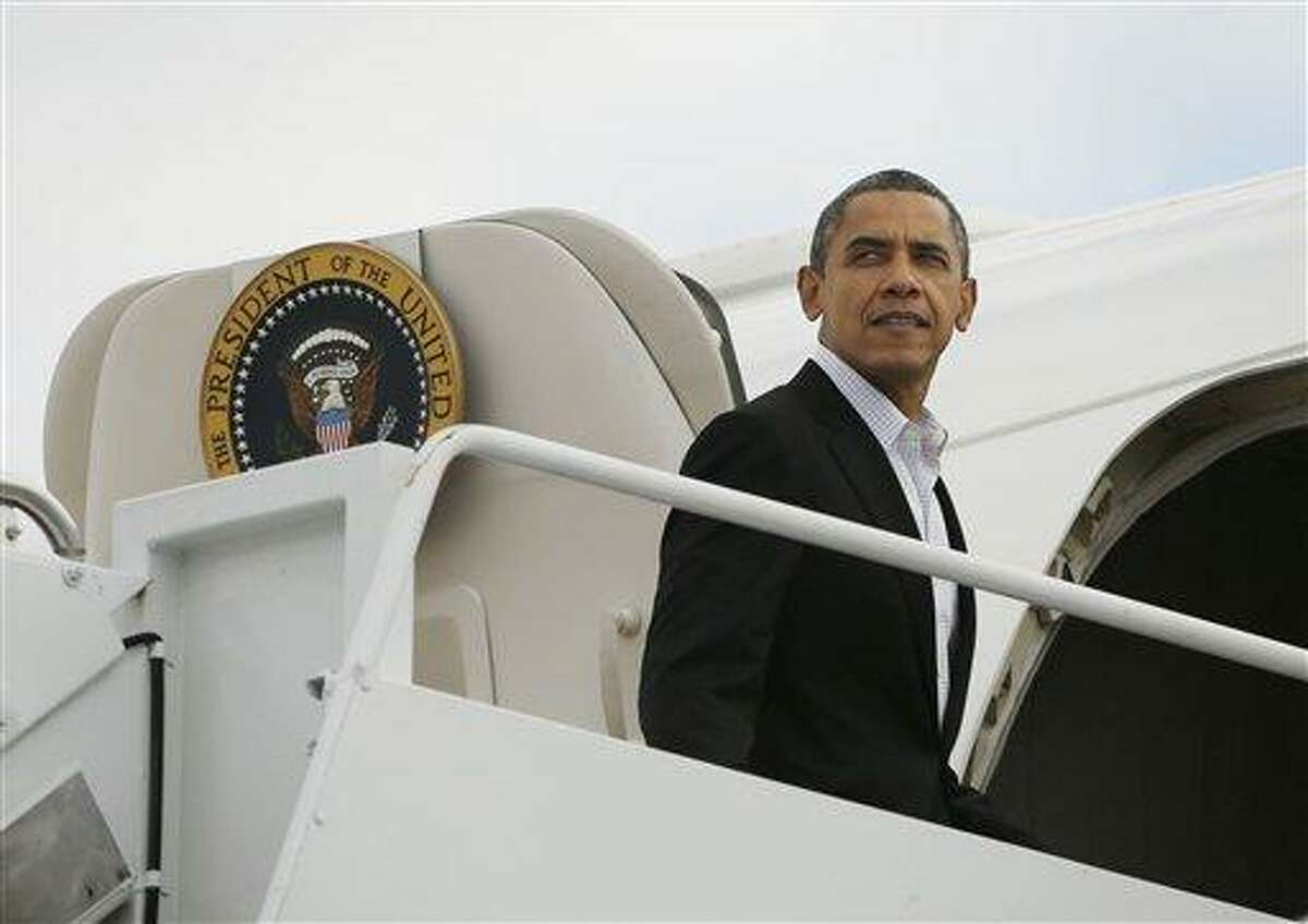 President Barack Obama is seen boarding Air Force One before his departure from Andrews Air Force Base, Saturday. AP Photo/Pablo Martinez Monsivais