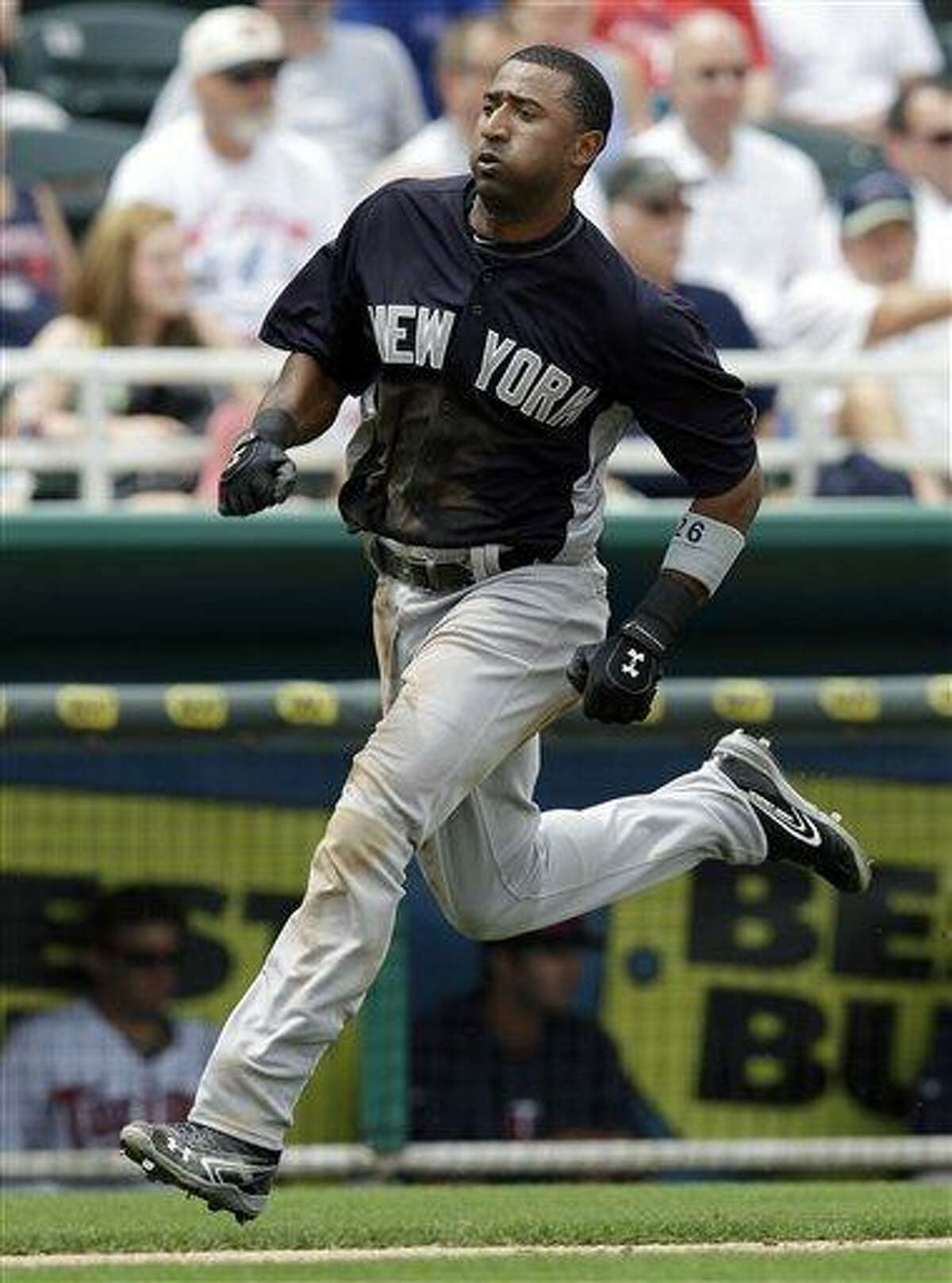 New York Yankees' Eduardo Nunez runs to home plate during an exhibition spring training baseball game against the Minnesota Twins in Fort Myers, Fla., Friday, March 22, 2013. (AP Photo/Elise Amendol12