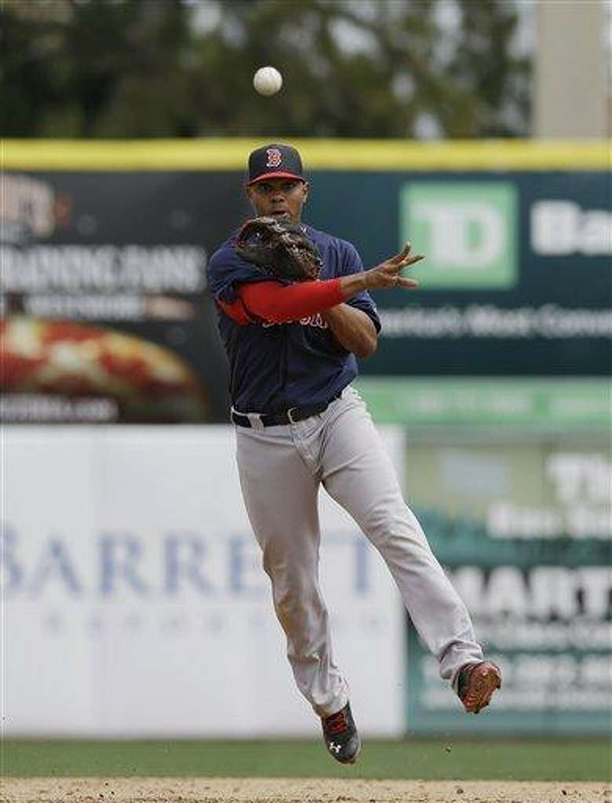 Boston Red Sox shortstop Xander Bogaerts (72) throws to first for a putout in a spring training baseball game against the Toronto Blue Jays in Dunedin, Fla., Friday, March 22, 2013. (AP Photo/Kathy Willens)