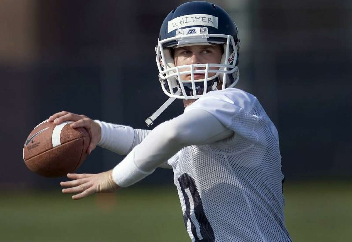 ASSOCIATED PRESS In this Aug. 3 file photo, Connecticut quarterback Chandler Whitmer throws during the teamís first practice of the season in Storrs. Whitmer will be the starting quarterback when the Huskies open the season on Thursday night against UMass at Rentschler Field in East Hartford.