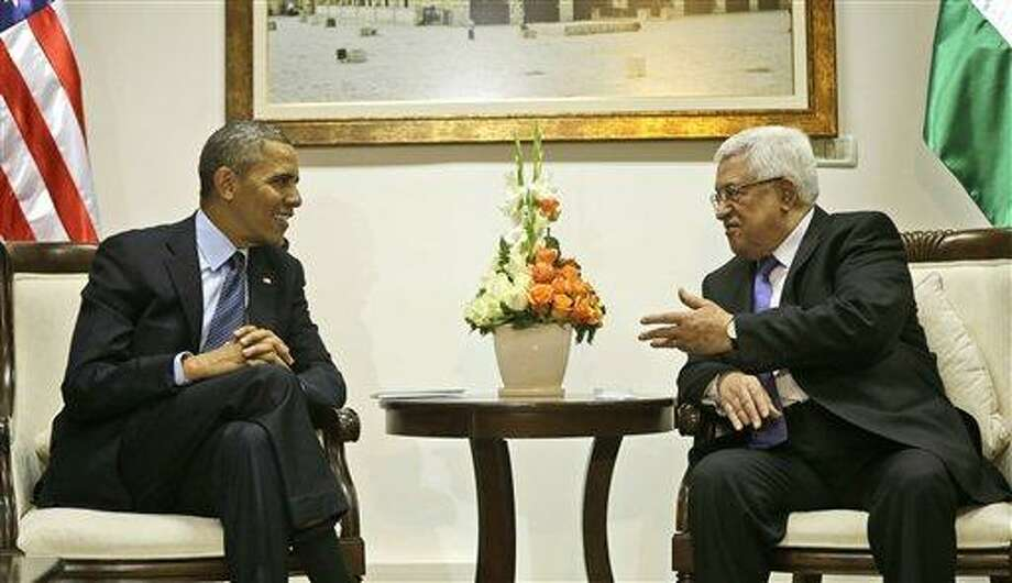 U.S. President Barack Obama, left, listens to Palestinian President Mahmoud Abbas during their bilateral meeting at the Muqata Presidential Compound in the West Bank city of Ramallah, Thursday, March 21, 2013. Obama is meeting Palestinian officials on the second day of his Mideast tour to emphasize the importance of reaching an Israeli-Palestinian peace deal, a message underscored Thursday when Palestinian militants in Gaza launched rockets into southern Israel.  (AP Photo/Pablo Martinez Monsivais) Photo: AP / AP