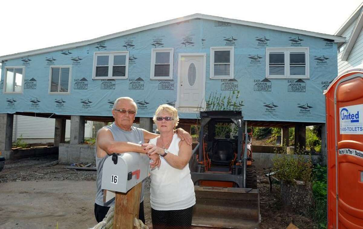 Frank Lombardi, 73, left, and Janet Pisani, 67, whose 16 Catherine Way home in the Cosey Beach neighborhood of East Haven was savaged by Tropical Storm Irene, are having difficulty with their insurance company and F.E.M.A. for proper compensation for rebuilding. Peter Hvizdak / New Haven Register