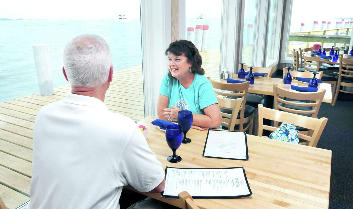 Edward and Bette (cq) Armstrong of Old Saybrook have window seats at the Dock & Dine restaurant in Old Saybrook when the restaurant reopened for dinner on 8/24/2012. Damage from Hurricane Irene closed the restaurant last year.Photo by Arnold Gold/New Haven Register AG0460A
