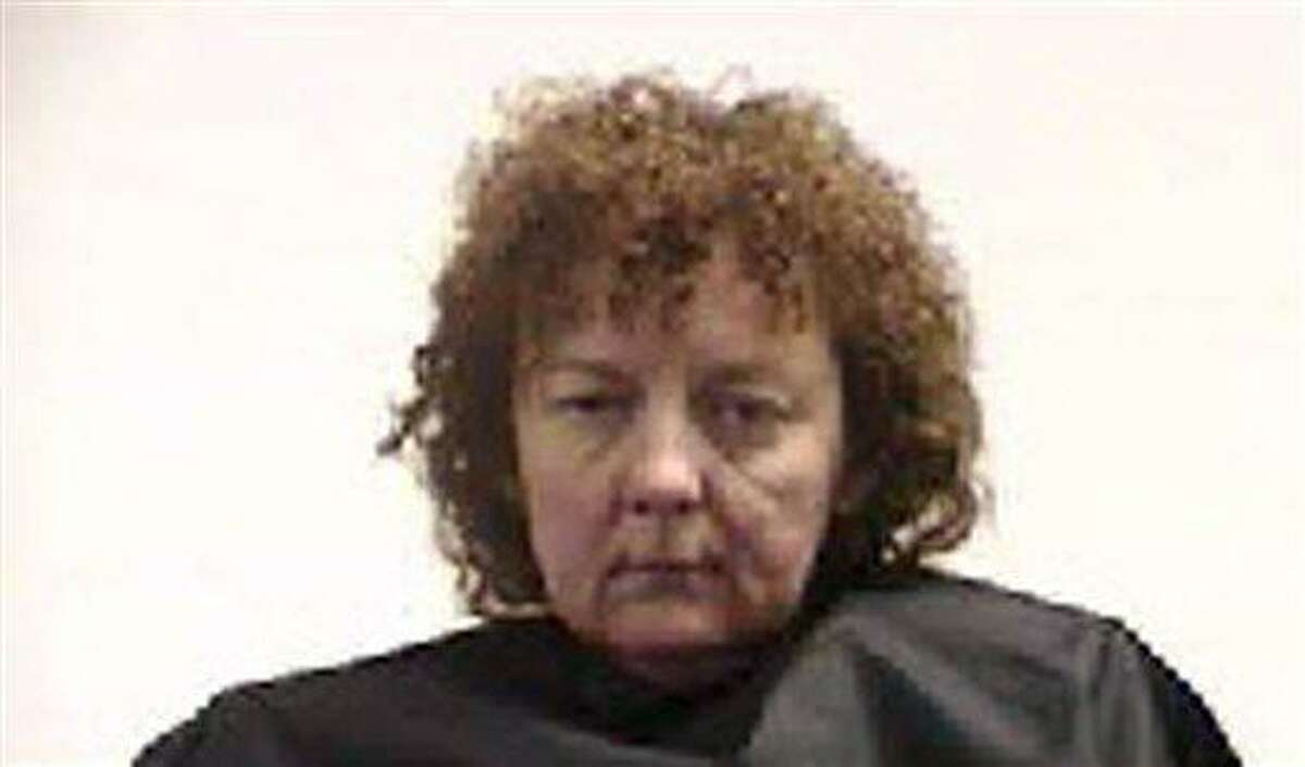 This undated photo released by the Pickens County Detention Center, S.C., shows Susan Hendricks of Liberty, S.C. Authorities say Hendricks killed her two sons, her ex-husband and her stepmother in October 2011, then tried to make it look like her son was the killer to collect about $700,000 worth of life insurance policies. Investigators say she left the gun used in all four killings by one of her sons and told deputies he was suicidal. In April, Hendricks pleaded guilty but mentally ill to all four of the Oct. 14, 2011, slayings and will spend the rest of her life in prison with no possibility of parole. (AP Photo/Pickens County Detention Center, File)