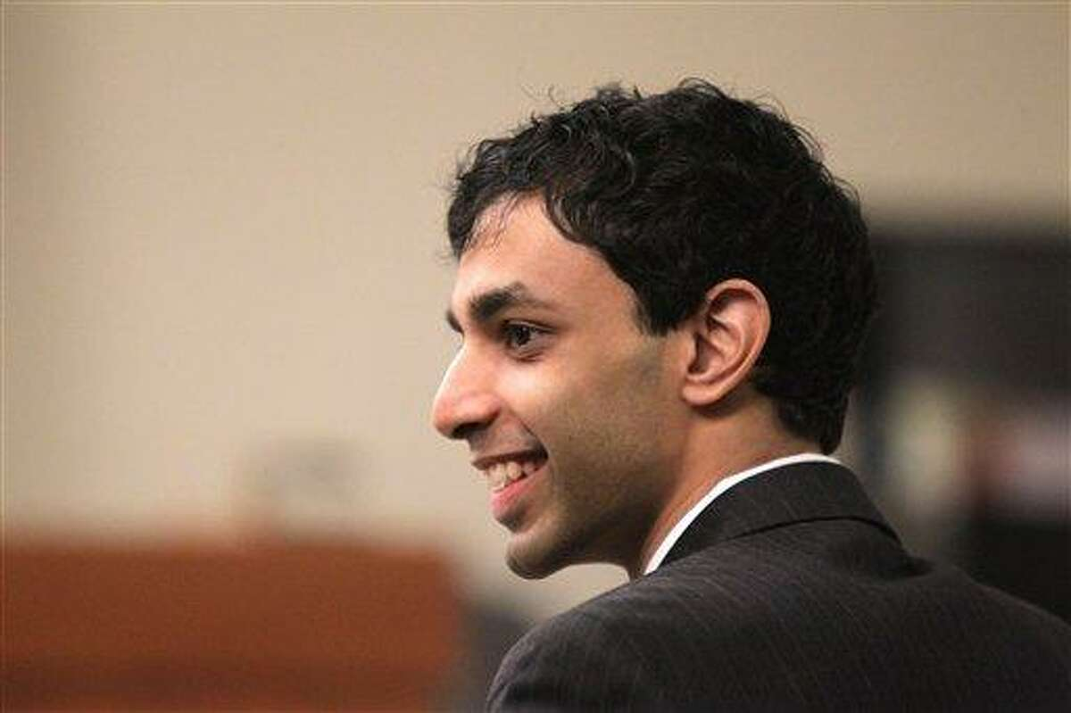 Dharun Ravi shares a laugh with his attorneys during a break in his trial Wednesday at the Middlesex County Courthouse in New Brunswick, N.J. Ravi,a former Rutgers University student, is accused of using a webcam to spy on his roommate, Tyler Clementi, during an intimate encounter with another man. Days later Clementi committed suicide. Associated Press