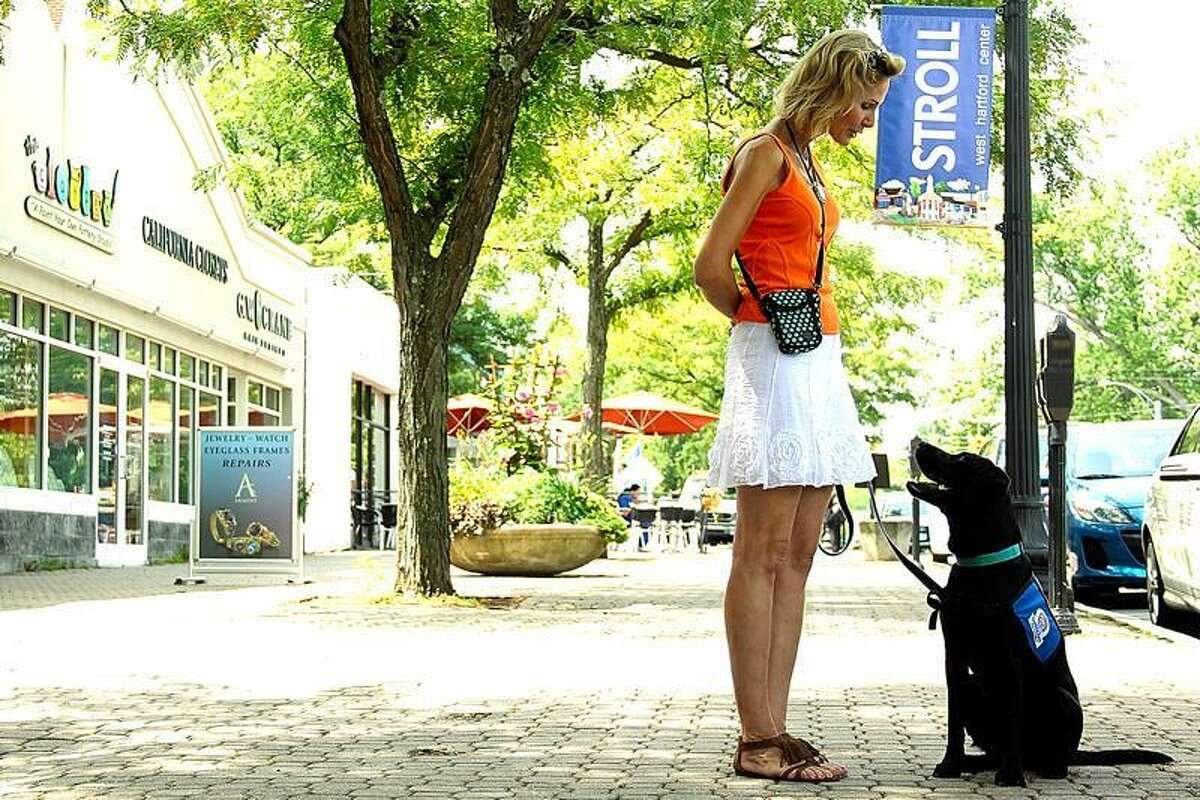 Diane Duxin and Silk walk regularly in West Hartford for exercise and socialization.