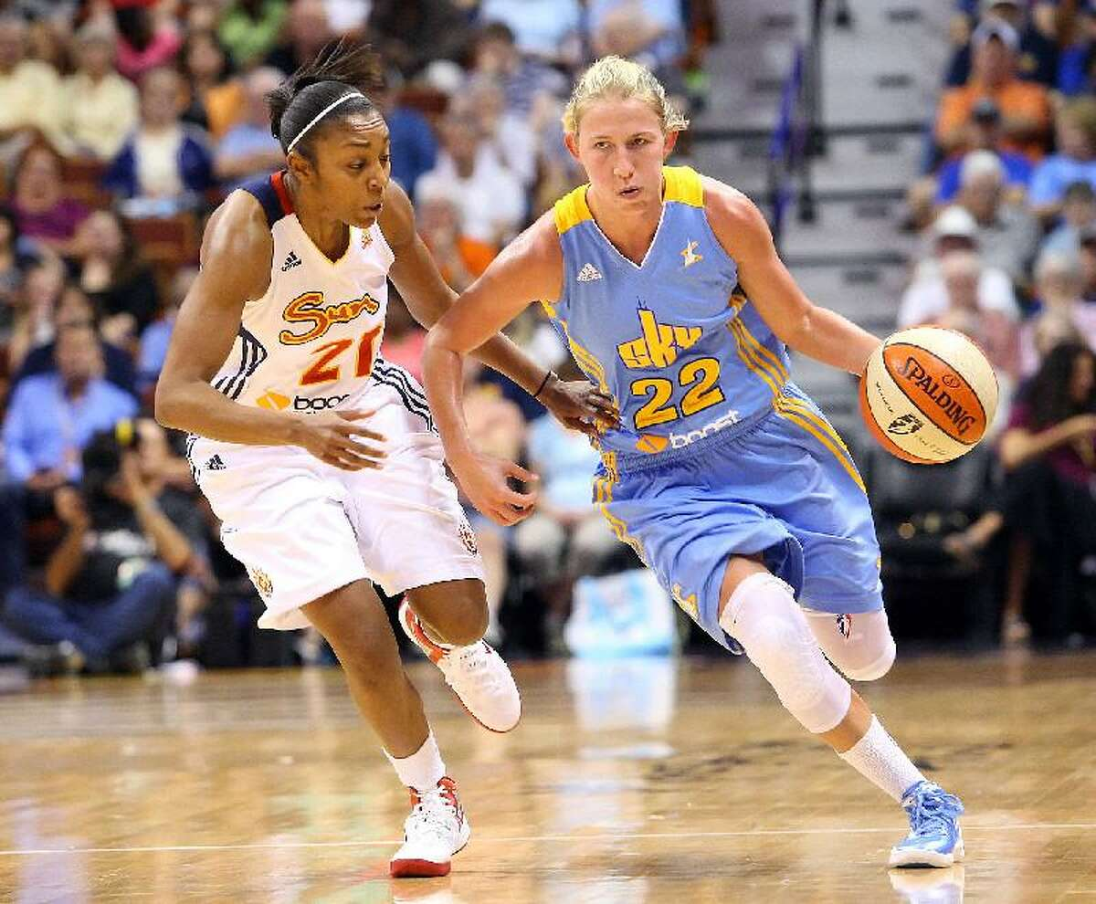 AP IMAGES/CAL SPORT MEDIA Chicago Sky guard Courtney Vandersloot (22) attempts to beat the press put on by Connecticut Sun guard Renee Montgomery (21) during Sunday's game at Mohegan Sun Arena in Uncasville. Chicago defeated Connecticut 82-70.