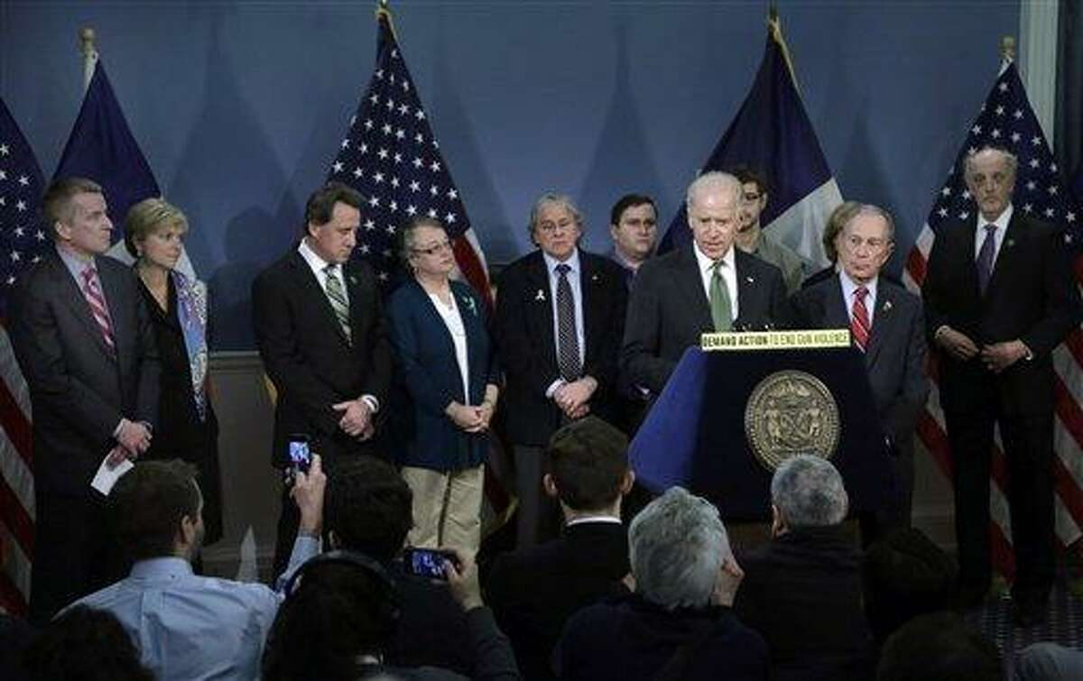 Chris and Lynn McDonnell, left, whose daughter Grace was killed in Newtown, Conn., and Neil Heslin, third left, whose son Jesse Lewis also died at the school shootings in Newtown, listen as Vice President Biden speaks in New York's City Hall Blue Room, Thursday, March 21, 2013. Relatives of shooting victims from Newtown, Conn., stood with New York Mayor Michael Bloomberg, foreground right, and Biden as they spoke in favor of an assault weapons ban. (AP Photo/Richard Drew)