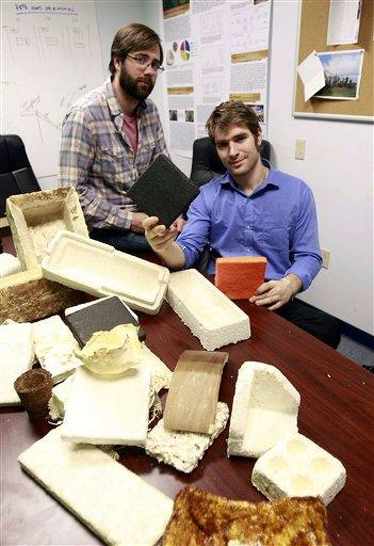Gavin McIntyre, left, and Eben Bayer, co-founders of Ecovative Design, pose with some of their eco-friendly packaging materials at their company in Green Island, N.Y., Thursday. Associated Press