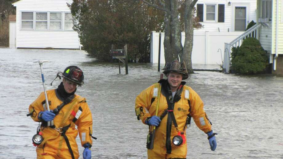 Old Saybrook firefighters Thomas Rochette, left, and Lt. James Dion respond to a water rescue scene.
