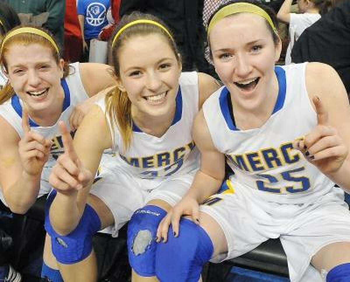 Senior Liz Falcigno, junior Morgan Cahill and sophomore Maura Fitzpatrick celebrate after defeating Lauralton Hall for the Class LL State Championship title at Mohegan Sun last Saturday. The Mercy Tigers defeated the Lauralton Hall Crusaders 54-53 to clinch the title. Photo by Catherine Avalone/The Middletown Press