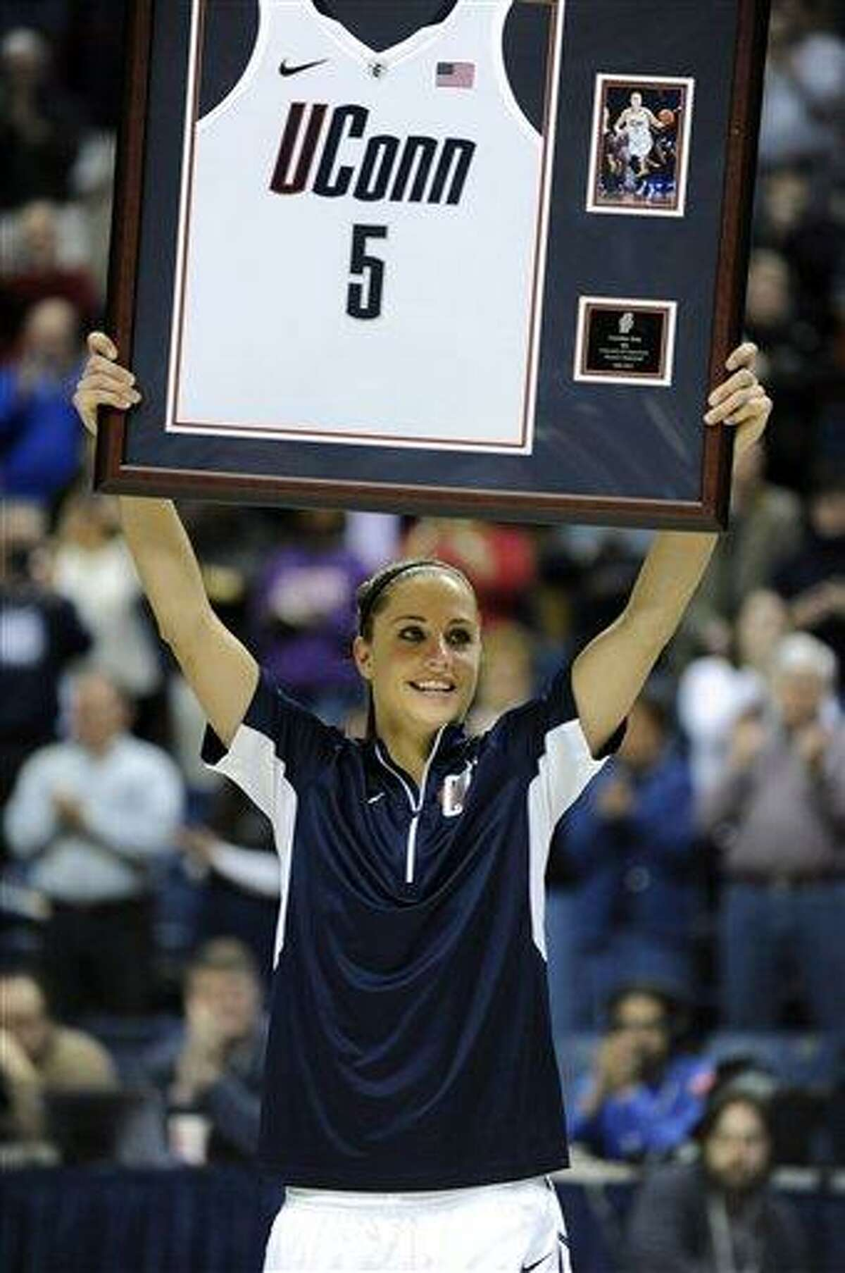 Caroline Doty holds up an award during Senior Night ceremonies before Connecticut's NCAA basketball game against Seton Hall in Storrs, Conn., Saturday, Feb. 23, 2013. (AP Photo/Fred Beckham)