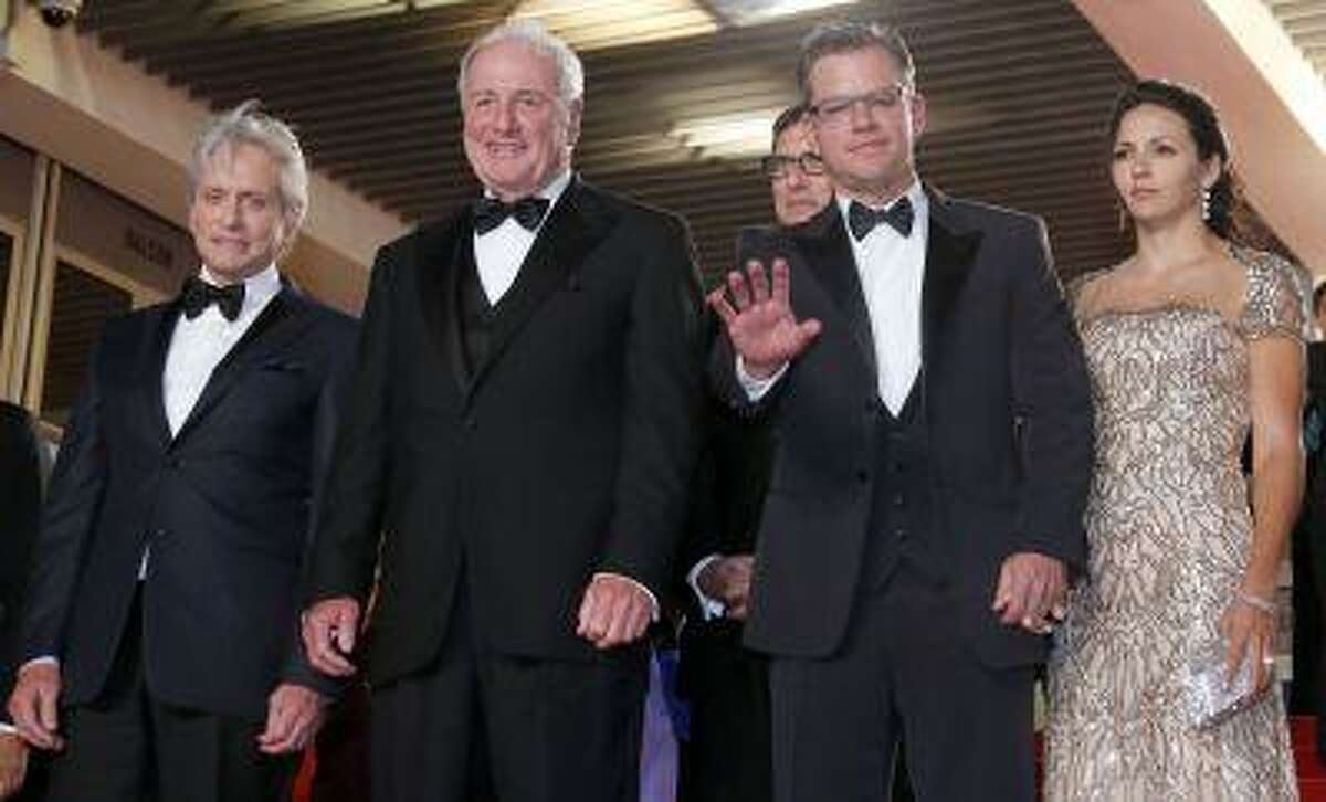 """(L-R) Cast member Michael Douglas, producer Jerry Weintraub, screenwriter Richard LaGravenese, cast member Matt Damon and his wife Luciana Barroso leave after the screening of the film """"Behind the Candelabra"""" in competition during the 66th Cannes Film Festival in Cannes May 21, 2013."""