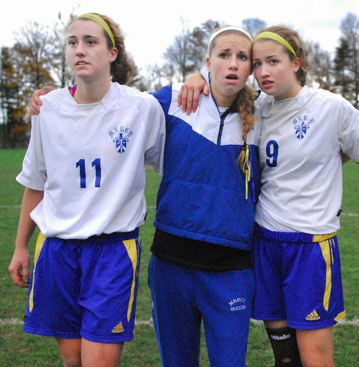 Catherine Avalone/The Middletown PressMercy senior captains Sheena Landy, Hope Tiezzi and Kelsey Pietruska during the second round of penalty kicks following a double overtime match against Shelton in the SCC semi final round Friday afternoon. Shelton defeated the Tigers (1-1) 7-5.