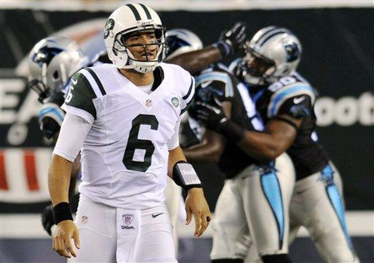 New York Jets quarterback Mark Sanchez (6) reacts as the Carolina Panthers defense celebrates a sack during the first half of a preseason NFL football game, Sunday, Aug. 26, 2012, in East Rutherford, N.J. (AP Photo/Bill Kostroun)