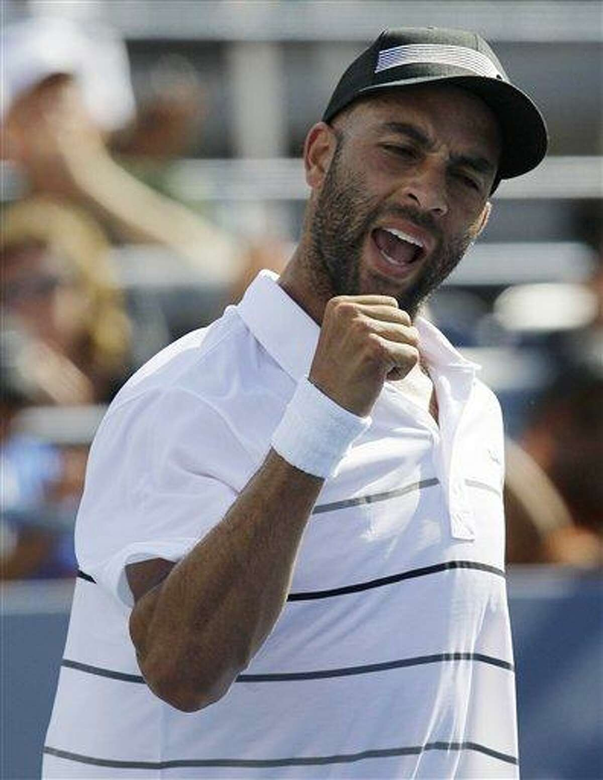 James Blake reacts after winning his match against Lukas Lacko, of Slovakia, in the first round of play at the 2012 US Open Tennis tournament, Monday, Aug. 27, 2012, in New York. (AP Photo/Kathy Willens)