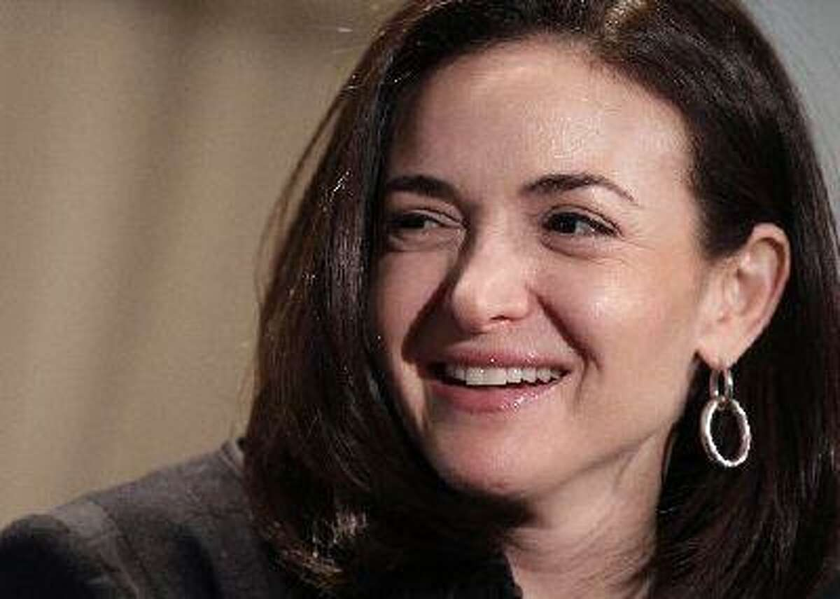 """In this Thursday, April 7, 2011, file photo, Sheryl Sandberg, Facebook's chief operating officer, speaks at a luncheon for the American Society of News Editors in San Diego. Sandberg's book """"Lean In: Women, Work, and the Will to Lead"""" went on sale Monday, March 11, 2013 amid criticism that she's too successful and rich to lead a movement. But she says her focus remains on spurring action and progress among women. (AP Photo/Gregory Bull)"""