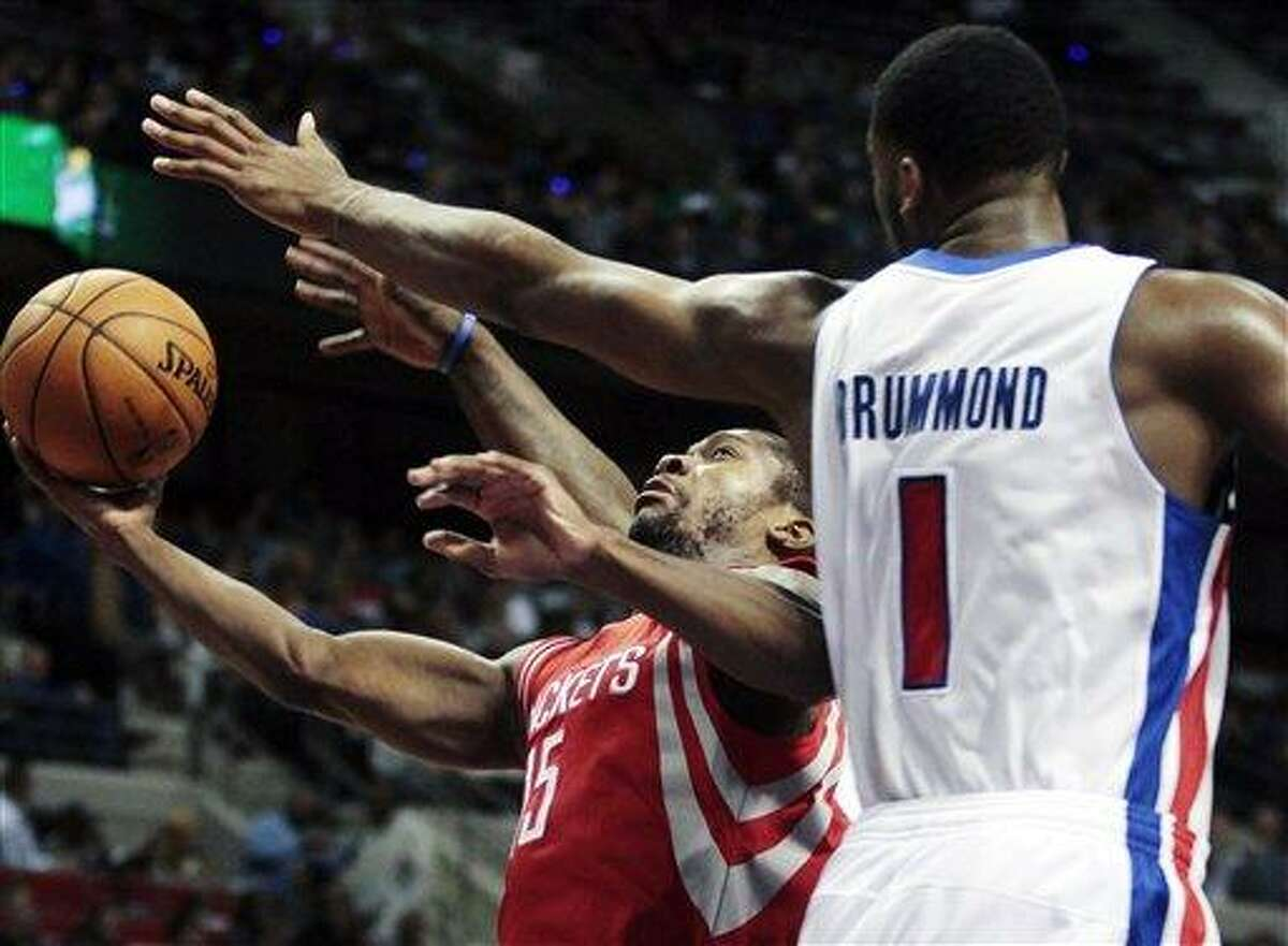 Houston Rockets guard Toney Douglas (15) goes to the basket against Detroit Pistons forward Andre Drummond (1) in the first half of an NBA basketball game, Wednesday, Oct. 31, 2012, in Detroit. (AP Photo/Duane Burleson)