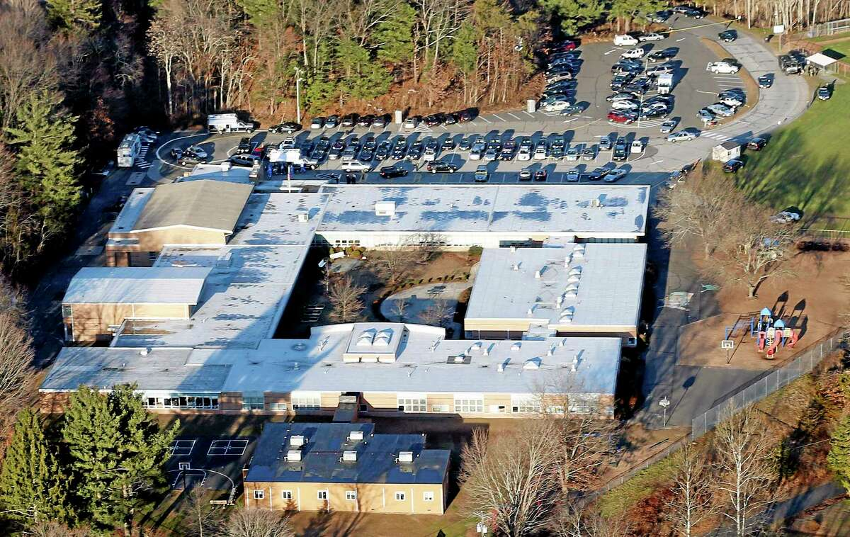FILE - This Dec. 14, 2012 aerial file photo shows Sandy Hook Elementary School in Newtown, Conn. Contractors demolishing Sandy Hook Elementary School are being required to sign confidentiality agreements forbidding public discussion of the site, photographs or disclosure of any information about the building where 26 people were fatally shot in December 2012. (AP Photo/Julio Cortez, File)