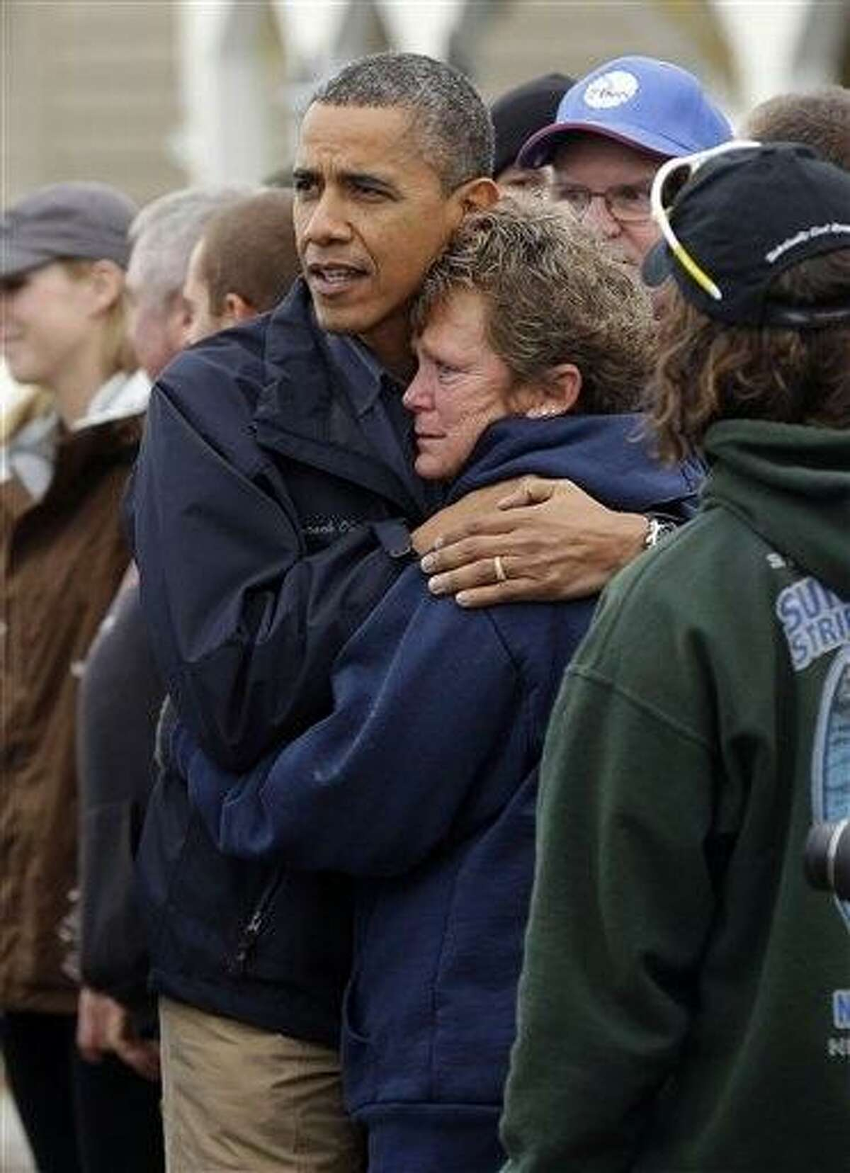 President Barack Obama, left, embraces Donna Vanzant, right, during a tour of a neighborhood effected by Hurricane Sandy, Wednesdayin Brigantine, N.J. Vanzant is a owner of North Point Marina, which was damaged by the storm. AP Photo/Pablo Martinez Monsivais