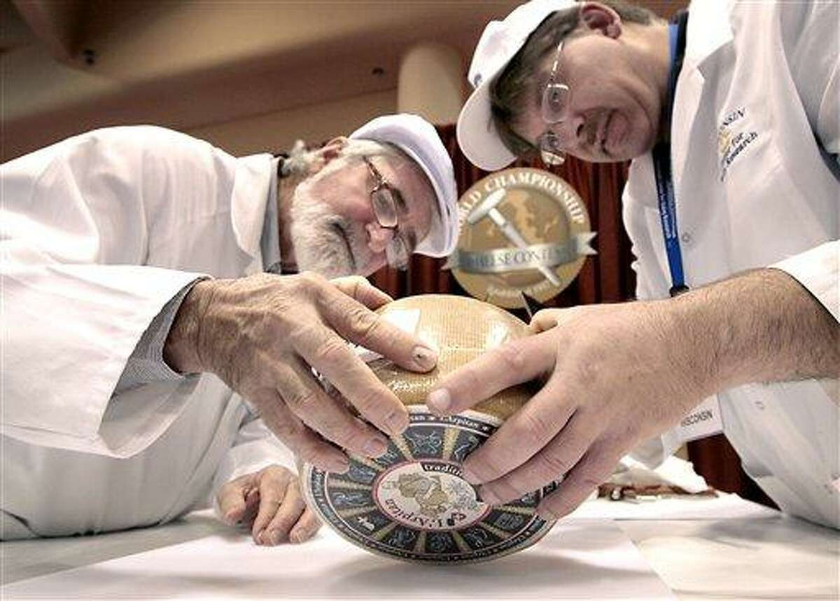 Russell Smith of Australia, left, and John Jaeggi of Madison prepare to sample one of the entries in the Smear Ripened Semi-soft Cheese category during the opening day of the World Championship Cheese Contest at the Monona Terrace Convention Center in Madison, Wis. on Monday. More than 2,500 entries will be judged throughout the three day gathering, sponsored every two years by the Wisconsin Cheese Makers Association. Associated Press