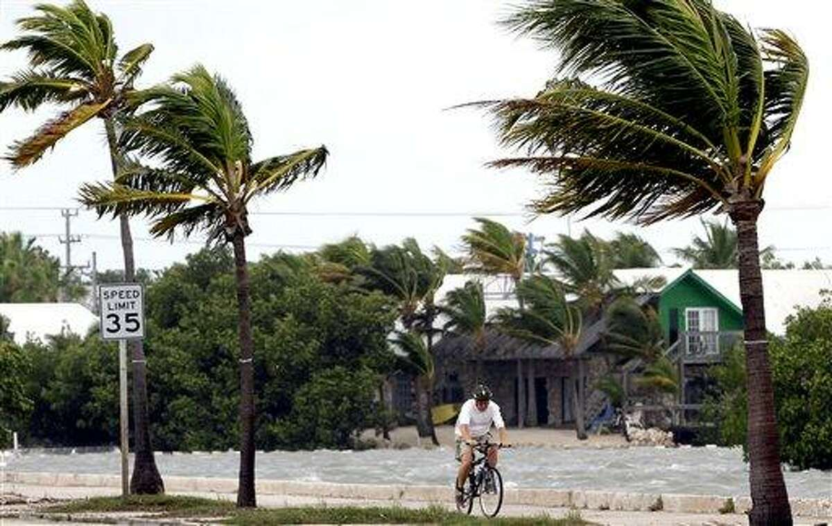 A cyclist rides his bike in Key West, Fla., Sunday, as Tropical Storm Isaac gained fresh muscle. Associated Press photo