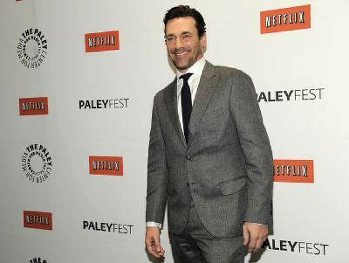 """FILE - In this March 13, 2012 file photo, Jon Hamm, a cast member in the television series """"Mad Men,"""" poses before the PaleyFest 2012 panel discussion about the show, in Beverly Hills, Calif. Hamm is going mad over Justin Timberlake's suit and tie, the song and the singer's style. The 42-year-old actor, who admitted to having an """"appreciation for fashion,"""" returns as womanizing ad man Don Draper when season six premieres April 7, 2013 on AMC. (AP Photo/Chris Pizzello, File)"""