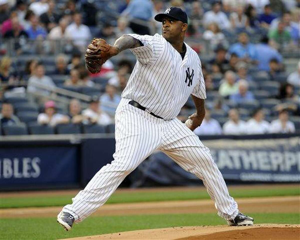 New York Yankees pitcher CC Sabathia delivers the ball to the Boston Red Sox during the first inning of a baseball game on Friday, May 31, 2013, at Yankee Stadium in New York. (AP Photo/Bill Kostroun)