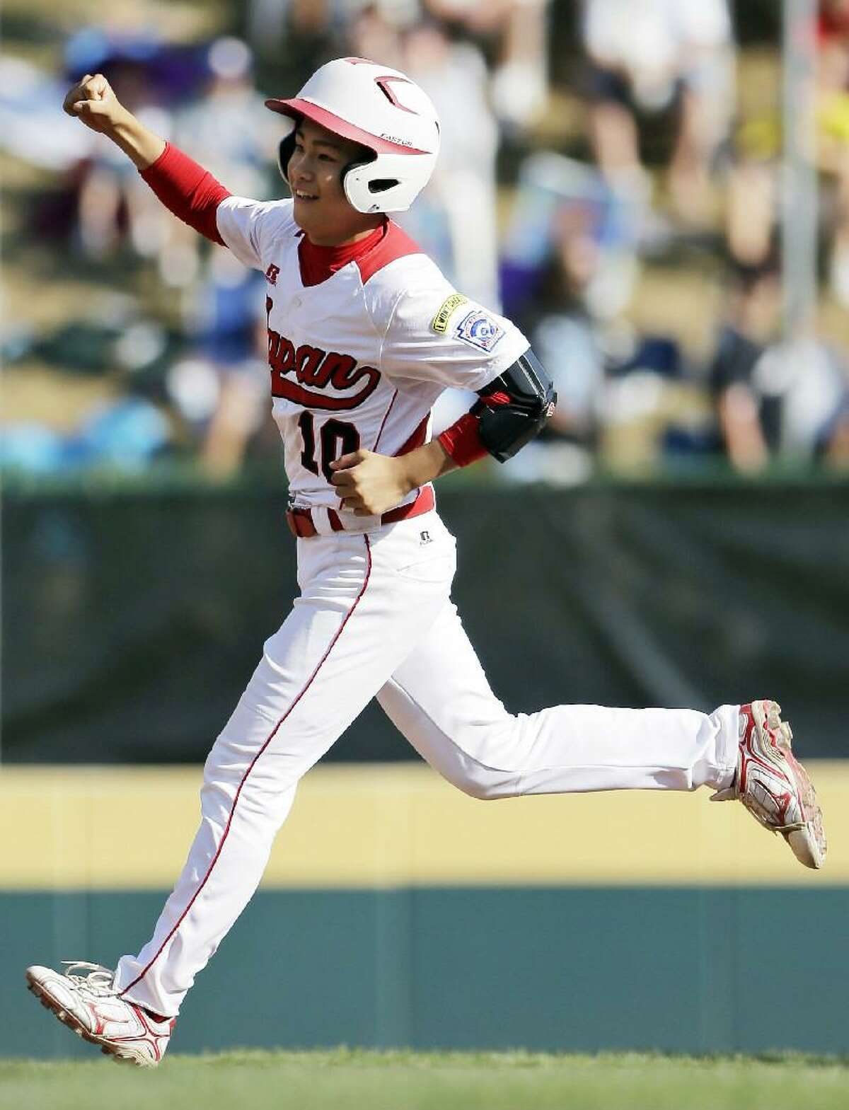 ASSOCIATED PRESS Tokyo, Japan's Noriatsu Osaka celebrates as he rounds the bases after hitting a two-run home run in the fifth inning of the Little League World Series championship baseball game against Goodlettsville, Tenn., Sunday in South Williamsport, Pa. Japan won 12-2 in five innings.