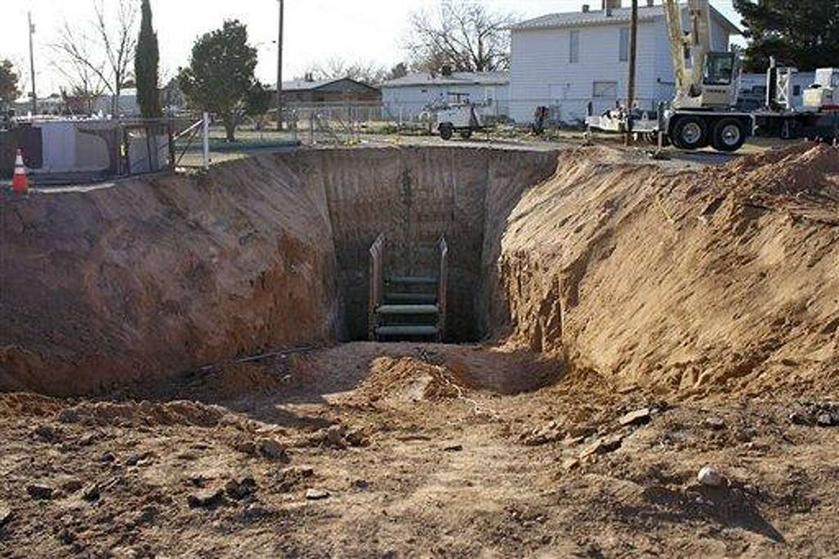 Heavy equipment stands near a narrow, 30-foot-deep hole in Carlsbad, N.M., Sunday, during an effort to recover the body of a 4-year-old boy two days after he fell into the hole. Associated Press