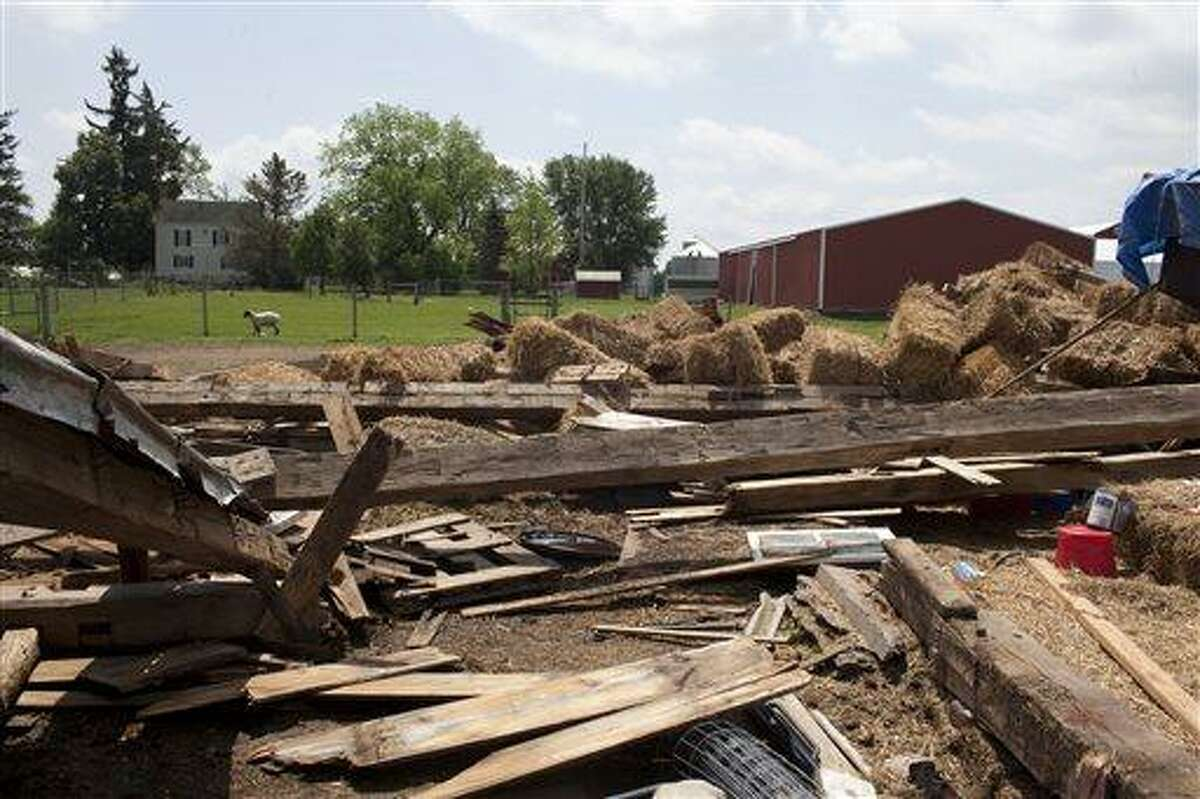 This May 29, 2013 photo shows a barn that collapsed from a suspected tornado in southwestern Genesee County, Mich. Weather experts confirmed Wednesday that six tornadoes touched down in southeastern Michigan as residents began cleaning up after powerful thunderstorms toppled power lines, downed trees and damaged homes and businesses the night before. No injuries were reported in and around Flint, where the twisters were clustered. The National Weather Service reported the tornadoes ranged in strength from EF-0 to EF-2 on a scale of zero to 5. (AP Photo/The Flint Journal, Sammy Jo Hester) LOCAL TV OUT; LOCAL INTERNET OUT