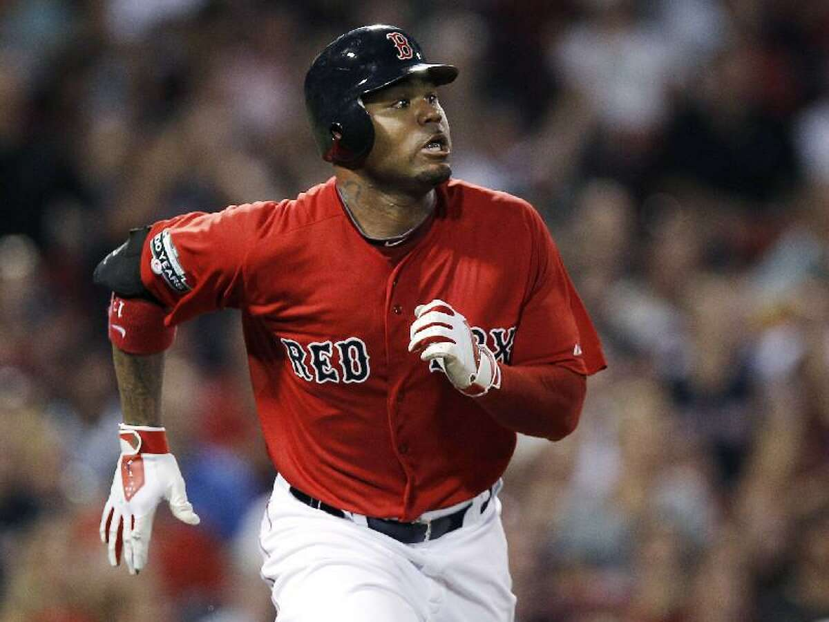 ASSOCIATED PRESS In this Aug. 3 file photo, Boston Red Sox's Carl Crawford watches his three-run home run against the Minnesota Twins during a game in Boston. The Red Sox have traded first baseman Adrian Gonzalez, pitcher Josh Beckett and Crawford to the Los Angeles Dodgers in a nine-player deal.
