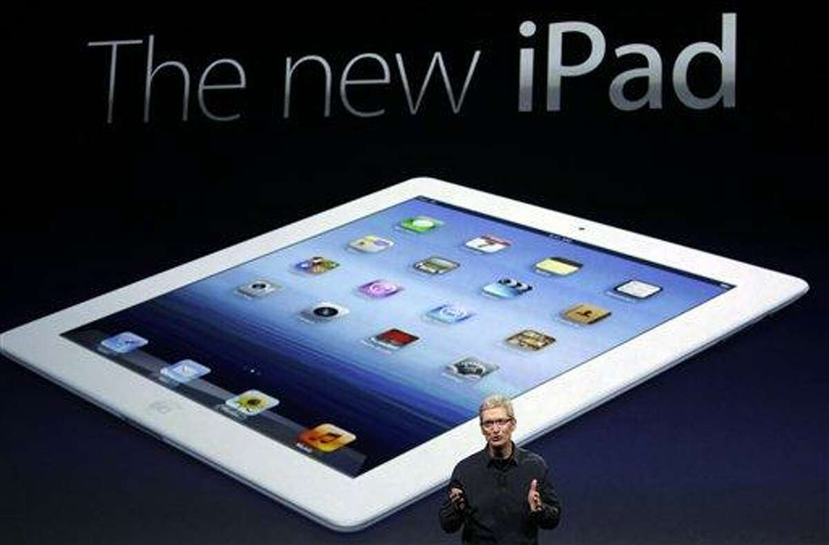 Apple CEO Tim Cook introduces the new iPad during an event Wednesday in San Francisco. The new iPad features a sharper screen and a faster processor. Apple says the new display will be even sharper than the high-definition television set in the living room. Associated Press