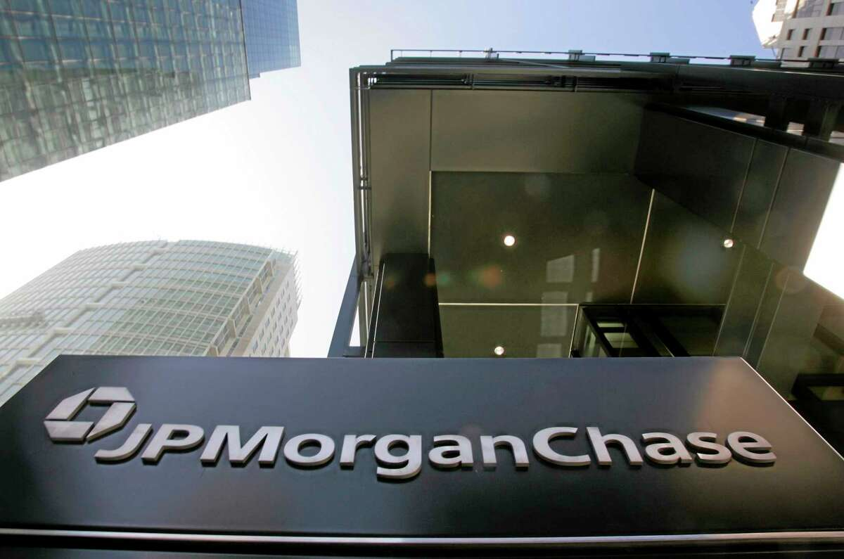 FILE - This Oct. 15, 2008, file photo, shows the exterior view of JPMorgan Chase offices in San Francisco. JPMorgan Chase, the biggest U.S. bank by assets, reported on Friday, Oct. 11, 2013, a third-quarter loss after a big charge for legal expenses. (AP Photo/Paul Sakuma, File)