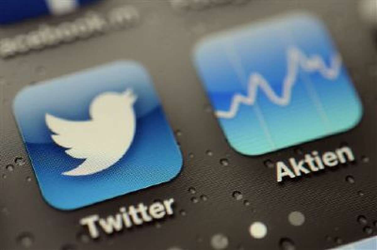 A Twitter App and stock tracker are shown on an iPhone in this Sept. 13 file photo.