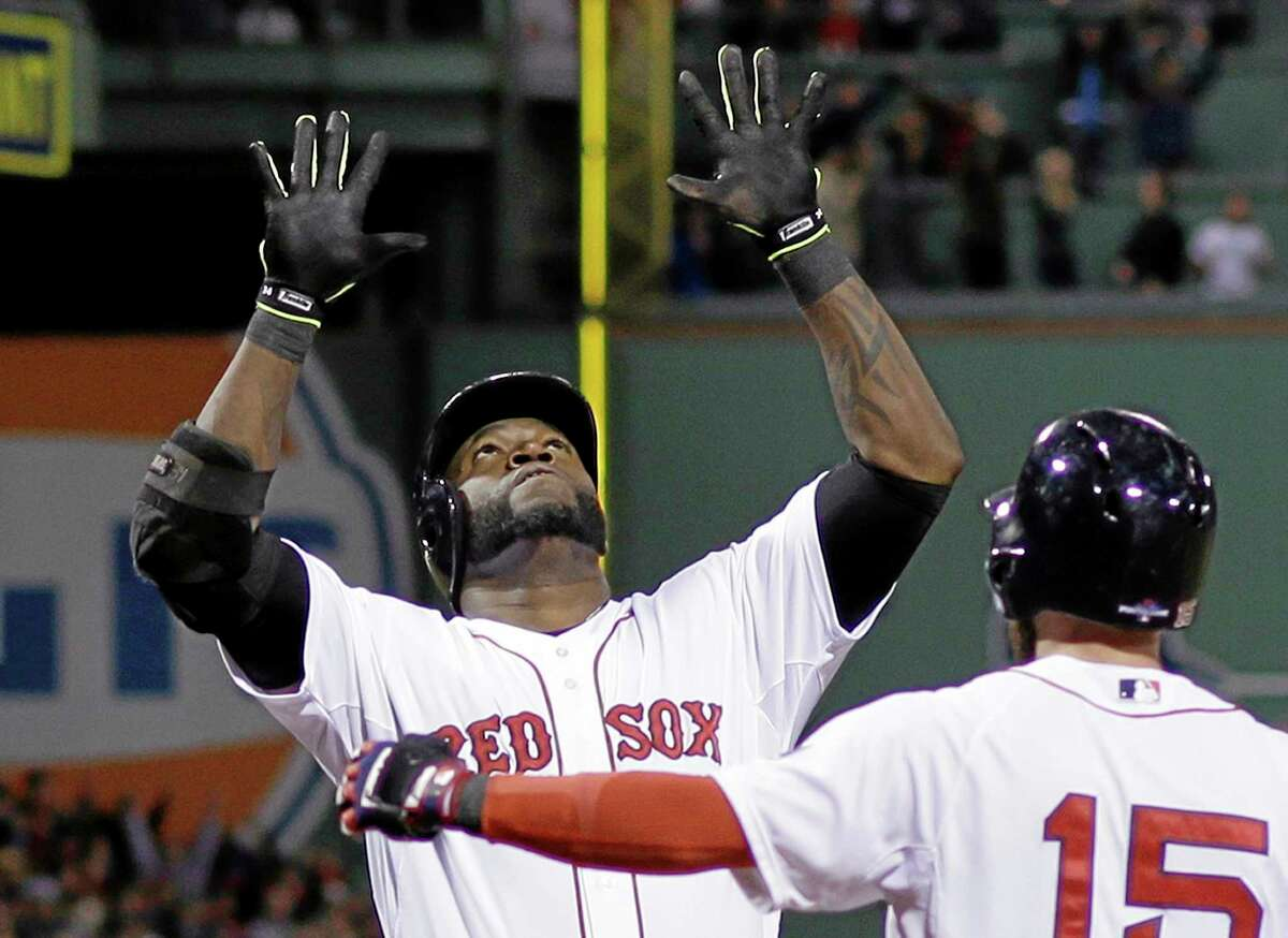 David Ortiz celebrates with Dustin Pedroia after hitting a grand slam in the eighth inning during Game 2 of the ALCS against the Tigers on Sunday in Boston.
