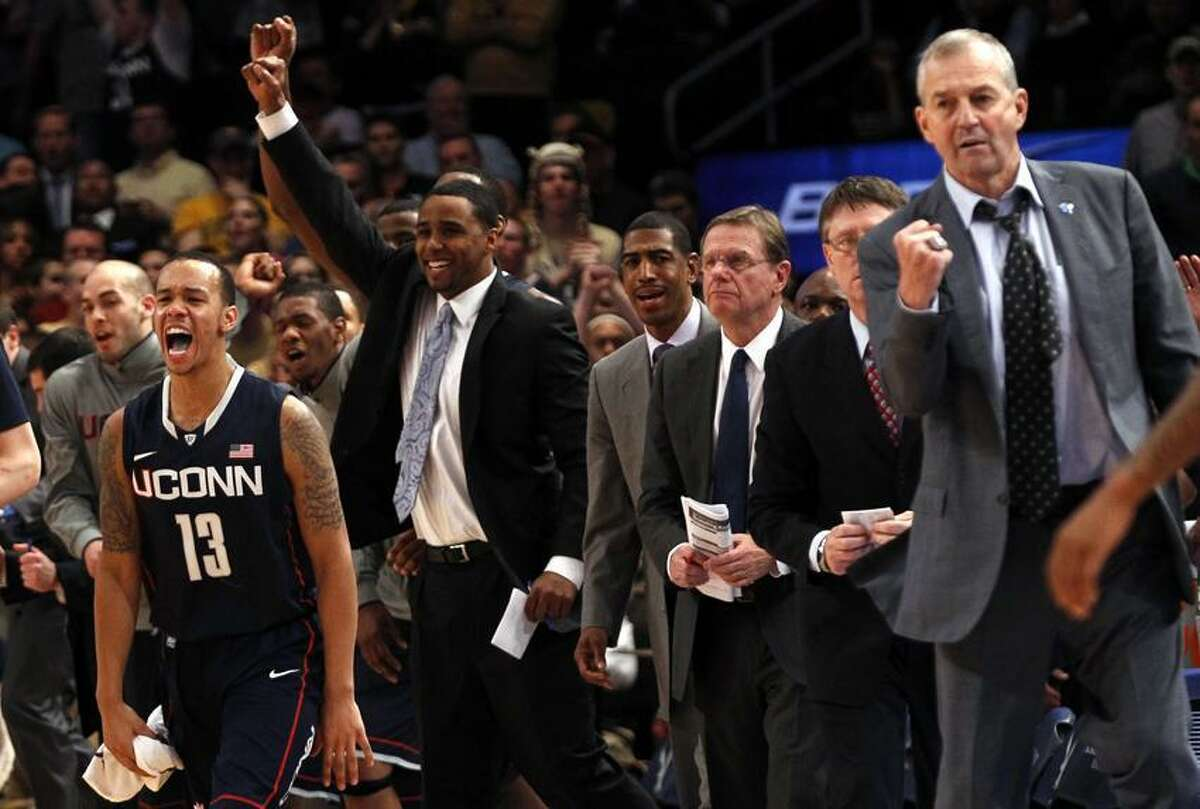 Uconn's Shabazz Napier (L) celebrates as time expires as UConn defeated West Virginia in overtime at the 2012 Big East men's NCAA college basketball tournament at Madison Square Garden in New York, March 7, 2012. At far right is UConn Head Coach Jim Calhoun. REUTERS/Mike Segar (UNITED STATES - Tags: SPORT BASKETBALL)