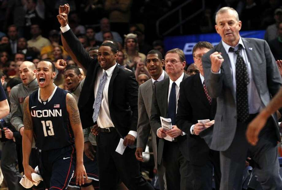 Uconn's Shabazz Napier (L) celebrates as time expires as UConn defeated West Virginia in overtime at the 2012 Big East men's NCAA college basketball tournament at Madison Square Garden in New York, March 7, 2012. At far right is UConn Head Coach Jim Calhoun.  REUTERS/Mike Segar    (UNITED STATES - Tags: SPORT BASKETBALL) Photo: REUTERS / X90033