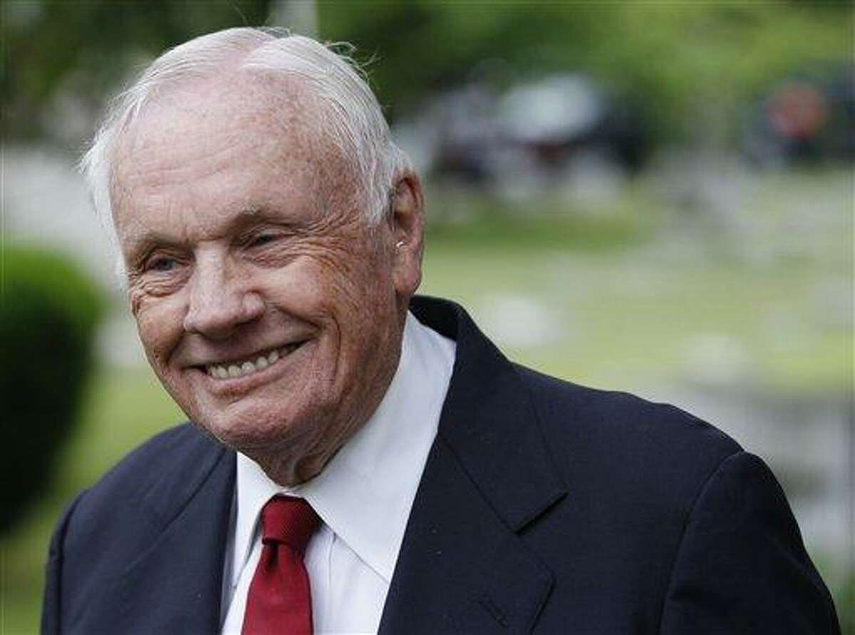 In this June 1, 2012, Neil Armstrong, the first man to walk on the moon, attends a graveside service for Wilbur Wright on the 100th anniversary of the burial of the powered flight pioneer in Dayton, Ohio. Armstrong died on Saturday, Aug. 25, 2012. (AP Photo/The Dayton Daily News, Chris Stewart) LOCAL PRINT OUT; LOCAL TV OUT; WKEF-TV OUT; WRGT-TV OUT; WDTN-TV OUT; MANDATORY CREDIT