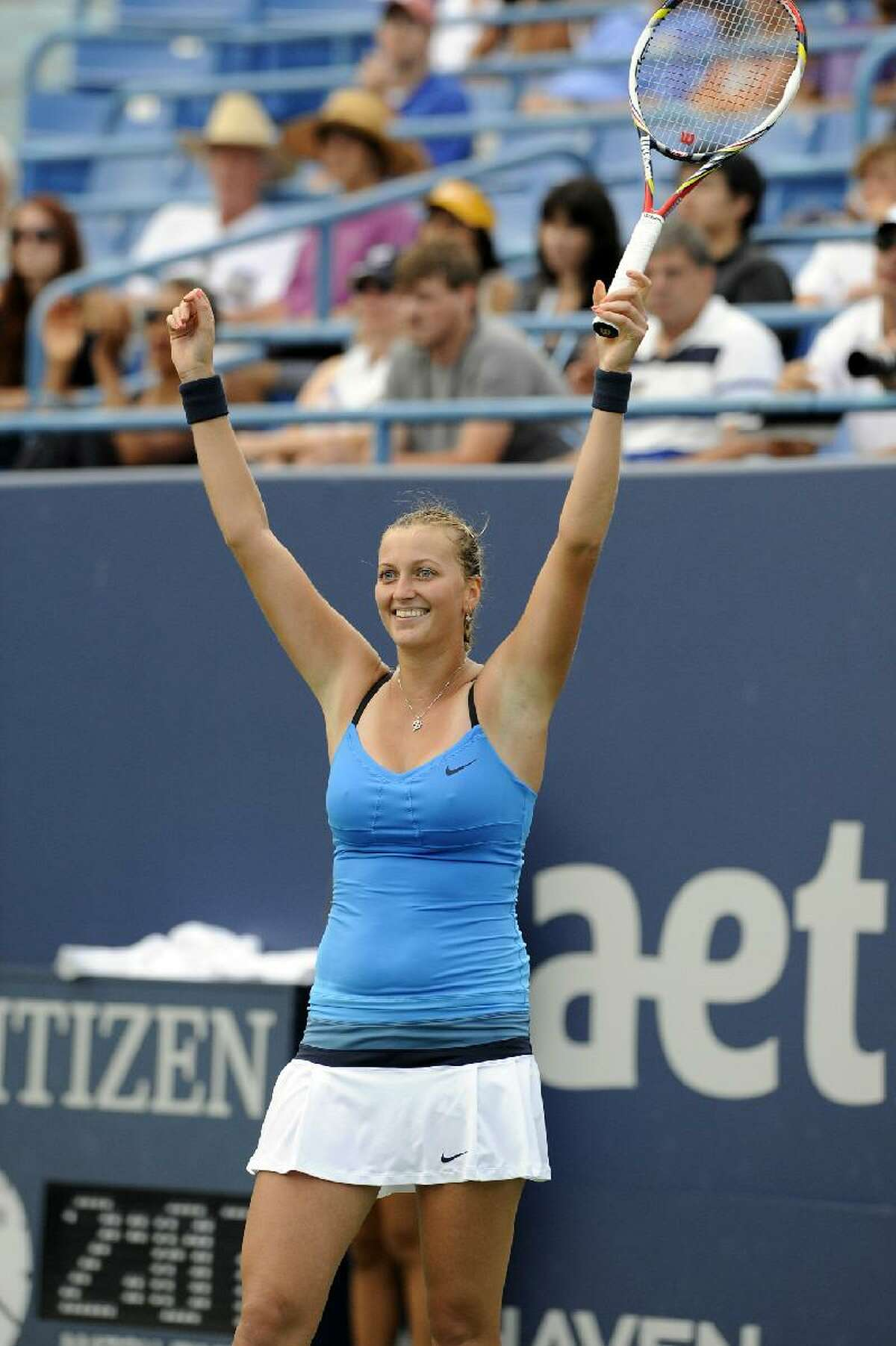 ASSOCIATED PRESS Petra Kvitova, of the Czech Republic, celebrates after her 7-6 (9), 7-5 victory over Maria Kirilenko, of Russia, in the title match of the New Haven Open tennis tournament in New Haven on Saturday.