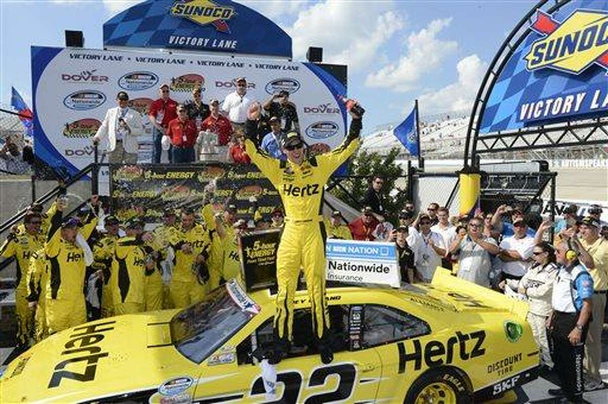 Driver Joey Logano celebrates atop of his car a second time as he poses for photos in Victory Lane after winning the NASCAR Nationwide Series auto race, Saturday, June 1, 2013, at Dover International Speedway in Dover, Del. Logano celebrated a second time after doing interviews after the first time. (AP Photo/Nick Wass)