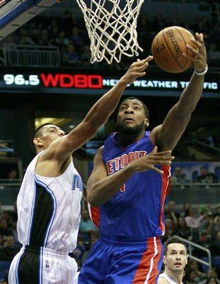 Detroit Pistons' Andre Drummond, right, makes a shot despite defensive effort by Orlando Magic's Gustavo Ayon, left, of Mexico, during the first half of an NBA basketball game, Wednesday, Nov. 21, 2012, in Orlando, Fla. (AP Photo/John Raoux) Photo: AP / AP