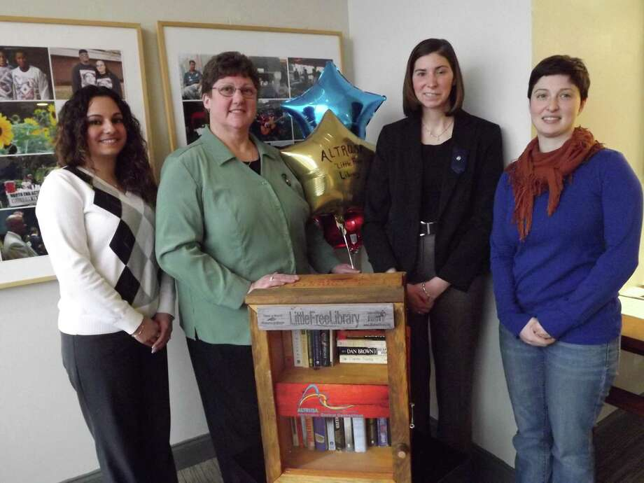 Picture taken by Patti Nettis Deegan Altrusa Club Members launch Little Free Library Stef Labbe (co-chair), Linda Ring (Altrusa President), Jamie Santangelo (co-chair) & Izzi Greenberg (NEAT Excutive Director)