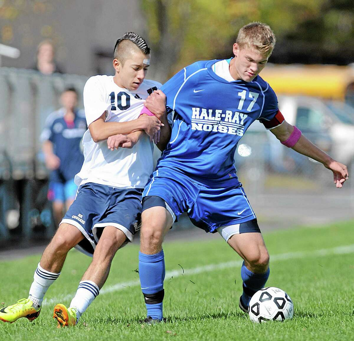 Haddam-Killingworth forward Liam Blancaflor defends Hale-Ray's Zack Wright in the first half of Monday afternoon's game. The Little Noises upset the Cougars, chalking up a 2-1 win in Higganum.