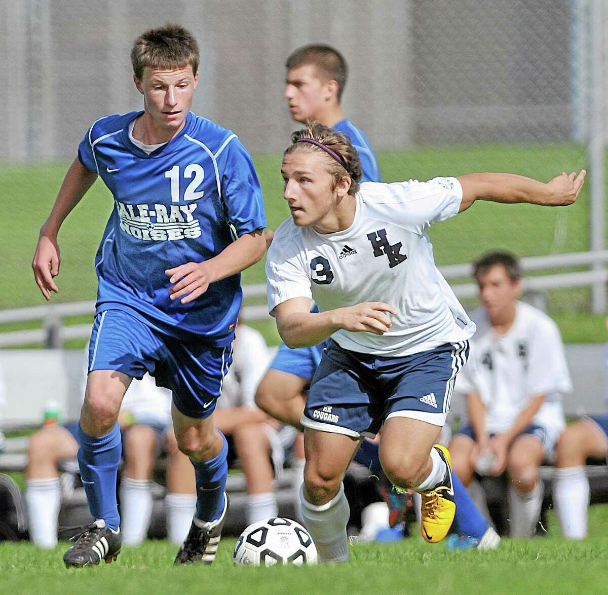 Haddam-Killingworth forward/midfielder Ryan Henderson moves the ball around Hale-Ray's Nick Pease in the second half of Monday's game in Higganum. The Little Noises won, 2-1.