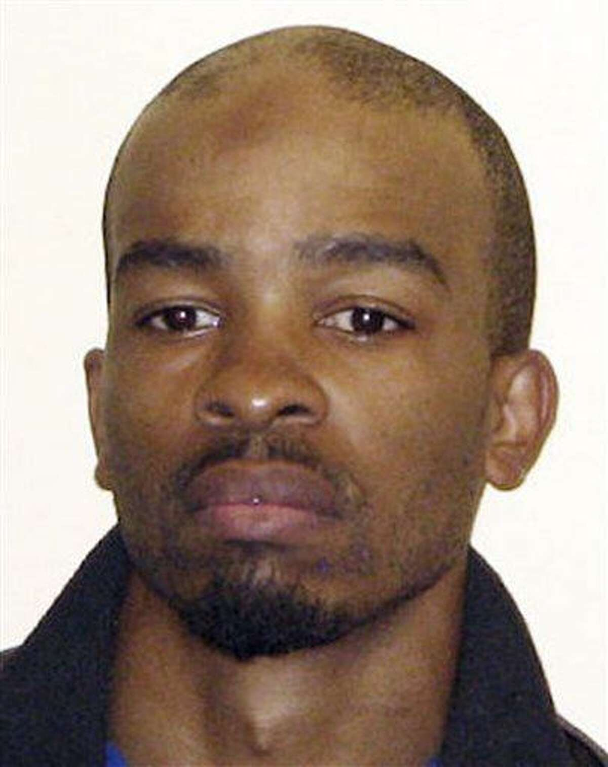 FILE - This undated file photo provided by the Cuyahoga County Sheriff Department shows Michael Madison. Authorities responding to a report of a foul odor from a home discovered a body and arrested a registered sex offender, Madison, who sent police and volunteers through a poor Ohio neighborhood in a search for more victims, officials said Sunday, July 21, 2013. The arraignment in Cleveland on charges of killing three women whose bodies were found wrapped in trash bags is scheduled Wednesday morning July 31, 2013 for 35-year-old Michael Madison. He is being held on $6 million bond. (AP Photo/Cuyahoga County Sheriff Department, File)